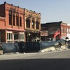 Staff photo by Mike Elswick<br /> A historic downtown Wagoner structure was demolished Tuesday as high winds resulted in safety issues when bricks from the top of the second story started falling about noon.