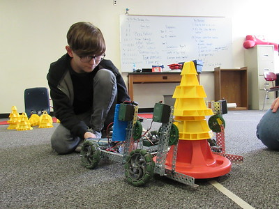 Staff photo by Cathy Spaulding Hilldale sixth-grader Ryan Dewhirst programs a robot to stack cones. He and other Middle School robotics team members recently won a VEX Robotics state competition.