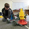 Staff photo by Cathy Spaulding<br /> Hilldale sixth-grader Ryan Dewhirst programs a robot to stack cones. He and other Middle School robotics team members recently won a VEX Robotics state competition.