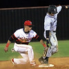 Phoenix special photo by John Hasler<br /> Hilldale shortstop Dee Folsom picks off Perkins' Cole Aldridge in Tuesday's game at Hilldale's diamond.