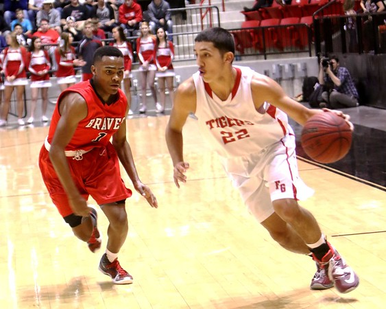 Phoenix file photo<br /> Rico Ybarra, right, shown against Tulsa Central in last year's playoffs, returns to the gym where his game-winning 3 against Harrah set the Tigers on a run to the Class 4A championship game. Fort Gibson meets Elgin at Edmond Santa Fe High School on Thursday.