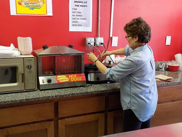 Staff photo by Mike Elswick<br /> Intermission Cafe manager Sharon Radeker stirs chili used for Frito pies or on all beef franks offered at the recently opened luncheon spot inside the historic Roxy Theater, 220 W. Okmulgee Ave.