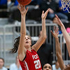 VON CASTOR/Special to the Phoenix<br /> Fort Gibson's Baylee London scores early in the Class 4A girls quarterfinal game over a Victory Christian defender Thursday afternoon at Mustang. The Lady Tigers lost 36-24 to end their season.