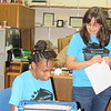 CATHY SPAULDING/Muskogee Phoenix<br /> Laquana Sango, left, a 2009 Oklahoma School for the Blind graduate prepares to judge the 2019 Braille Challenge while OSB teacher Faye Miller watches.