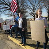 Staff photo by Cathy Spaulding<br /> Muskogee High School sophomore Mason Page holds an American flag while an MHS freshman holds a protest sign Thursday during an after-school protest.