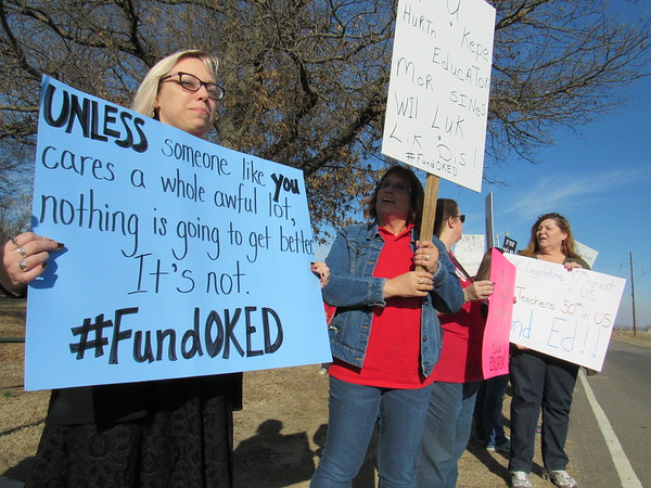 Staff photo by Cathy Spaulding<br /> Cherokee Elementary librarian Gina Batie, left and Creek Elementary teacher Angela Cummings share their sentiments during a Thursday afternoon protest at Muskogee High School.