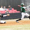 John Hasler/Special to the Phoenix<br /> Muskogee's Caleb Webb, right, cranks out a two-run double in the top of the third as Wagoner catcher Max Brown looks on during the Roughers' 12-7 extra-inning win at Wagoner on Friday.