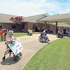 CATHY SPAULDING/Muskogee Phoenix<br /> Fort Gibson Nursing Home residents are spaced at least 6 feet apart as they await a Friday parade in front of the home. The parade featured residents' families and caregivers, as well as Fort Gibson fire and police.