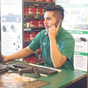 RONN ROWLAND/Muskogee Phoenix<br /> Luis Hernandez of O'Reilly Auto Parts on North Main Street helps a customer on the phone with a question about a part. Auto parts stores in the area are seeing a rapid increase in business during the COVID-19 pandemic.