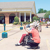 KENTON BROOKS/Muskogee Phoenix<br /> Residents and staff at Eastgate Village Healthcare Center spent part of their afternoon Wednesday enjoying the sun and a parade of well-wishers made up of family and friends who drove by with signs and balloons. Read the story on the Health page.
