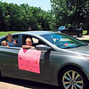 KENTON BROOKS/Muskogee Phoenix<br /> <br /> Family members waves to their loved one during the Eastgate Village Retirement Center's parade on Wednesday. This family was in one of 56 cars that drove through the center's parking lot. The parade, an idea by Activities Director Marissa Berry was held because visitors are not allowed inside the center during the COVID-19 pandemic and social distancing is in use. The 30-minute parade also included the Cruis'n Angels Car Club.