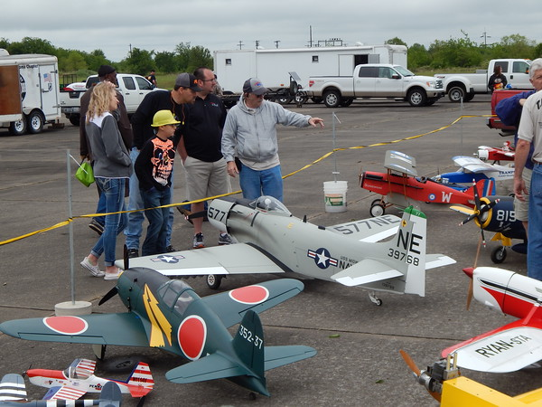 Staff photo by Mark Hughes<br /> A member of Three Rivers Area Model Plane Society describes one of the 22 remote-controlled aircraft brought for display at Saturday's Touch-A-Truck.