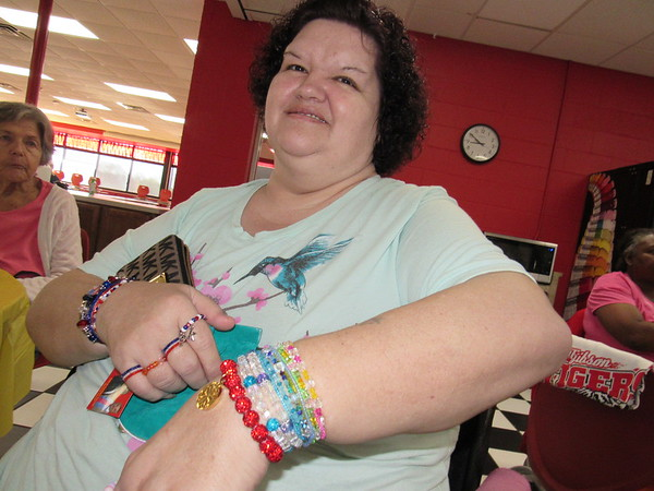 CATHY SPAULDING/Muskogee Phoenix<br /> Patricia Kiser shows off the Rustic Cuff bracelet she won with a winning ticket at the Fort Gibson Golden Agers Breakfast. She said it came just in time for her birthday.