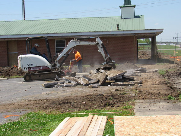 CATHY SPAULDING/Muskogee Phoenix<br /> An excavator moves chunks from a parking lot by the former Wesley United Methodist Church, while another worker runs a concrete saw. Hilldale Public Schools is converting the former church, 313 E. Peak Blvd. into administrative offices. Superintendent Dr. Kaylin Coody said the renovation is being paid through the district building fund. Hilldale bought the church in 2014. Construction is expected to be completed this summer. The district administration offices currently are at 500 Smith Ferry Road.