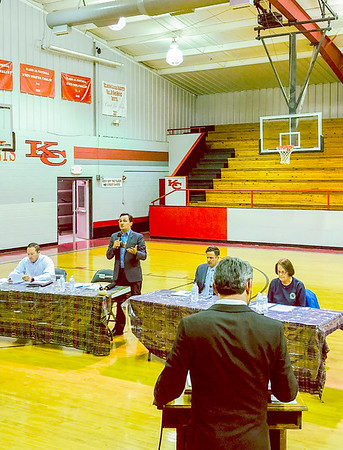 D.E. SMOOT/Muskogee Phoenix<br /> Former Secretary of State Chuck Hoskin Jr., standing, discusses the impact the poultry industry has had on communities Tuesday during a debate between two candidates for principal chief of the Cherokee Nation. Also pictured, from left, are Tribal Councilors Bryan Warner, David Walkingstick and former Tribal Councilor Meredith Frailey.