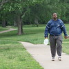 CATHY SPAULDING/Muskogee Phoenix<br /> Allante Hall of Muskogee gets a brisk midday walk around Civitan Park as storms were predicted Tuesday afternoon. Thunderstorms are expected Wednesday, Thursday and Friday, according to Muskogee's AccuWeather website.