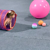 ANDREA CHANCELLOR/Special to the Phoenix<br /> Baby gymnast crawls through a play tunnel