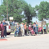 CATHY SPAULDING/Muskogee Phoenix<br /> People gather outside the Jack C. Montgomery VA Medical Center and Five Civilized Tribes Museum to watch a Thursday afternoon flyover by the Oklahoma Air National Guard.