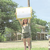 Diana Moss stands on the Five Civilized Tribes Museum lawn to show her support for workers and veterans at the Jack C. Montgomery VA Medical Center. Moss came to watch F-16 fighter jets do a flyover saluting health care workers tackling COVID-19.