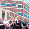 """CATHY SPAULDING/Muskogee Phoenix<br /> <br /> Technologists and other Jack C. Montgomery VA Medical Center staff members watch F-16 fighter jets fly over the hospital. The Oklahoma Air National Guard did a flyover to salute people """"on the front lines"""" against COVID-19."""