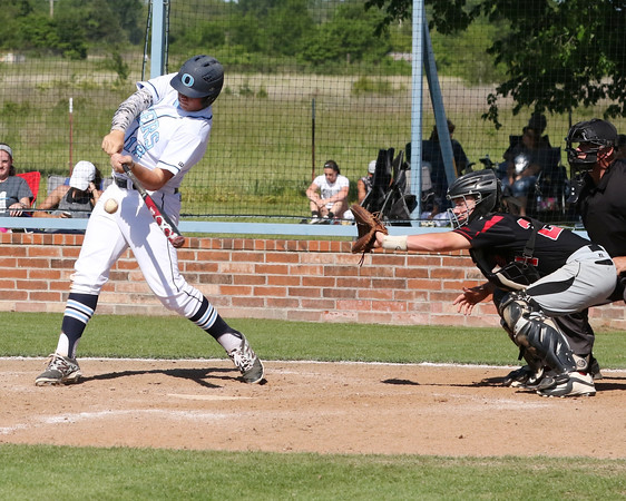 Special photo by John Hasler<br /> Oktaha's Dru Didway drives in the first run of Friday's Class 2A regional championship game against Panama at Oktaha High School. The Tigers won 18-2.