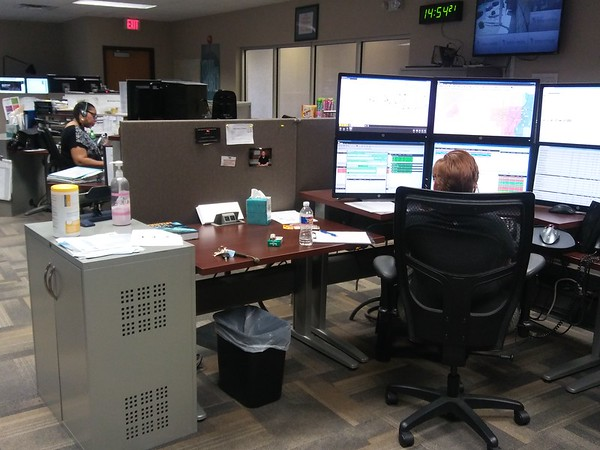 Staff photo by Wendy Burton<br /> Dispatchers work in the Muskogee City-County E911 Call Center, a service only half funded through landline phone 911 fees and wireless phone 911 fees.