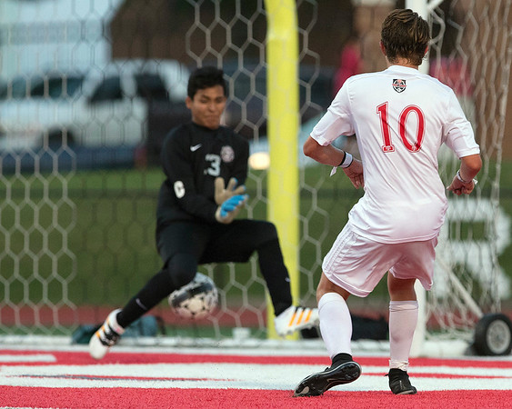 Phoenix special photo by Von Castor<br /> Fort Gibson's Grayson Ramey slips a shot through the legs of Crooked Oak goalkeeper Andres Fuentes for the go-ahead goal Tuesday night in a 2-1 Class 4A boys semifinal victory for the Tigers.