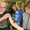 Staff photo by Cathy Spaulding<br /> Fifth-grader Ryan Thomason, left, lets a bug crawl up his arm while classmate Darrell Sampson winces. Students inspected insects, a snake and a variety of rocks, gems and minerals on Thursday during Warner STEM Wars.