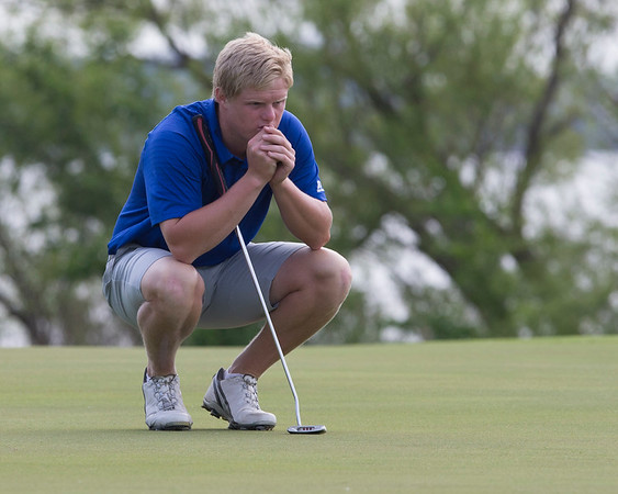 Phoenix special photo by Von Castor<br /> Checotah's Brice Terry studies a putt during Tuesday's third and final round of the Class 4A golf tourney at Lake Hefner North course in Oklahoma City.