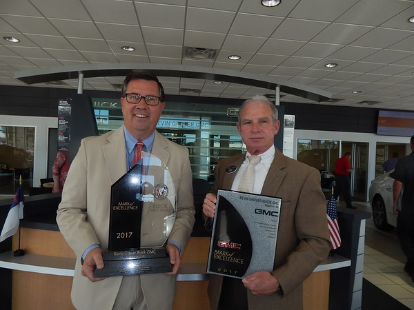 KENTON BROOKS/Muskogee Phoenix<br /> Kevin Grover, president of Kevin Grover Buick GMC, stands with District Sales Manager Gene Jacobs, right, after Grover was presented two awards Wednesday from Buick and GMC by District Sales Manager Gene Jacobs of Tulsa.