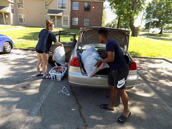 MIKE ELSWICK/Muskogee Phoenix<br /> Bacone College sophomore student Dakim Rivera is seen helping fellow sophomore Dominique Webster load up her car on Wednesday afternoon as she prepared to move off campus. With officials announcing operations at the college will be suspended beginning Monday on at least a temporary basis, the students said their future college plans are in limbo.