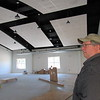 CATHY SPAULDING/Muskogee Phoenix<br /> Muskogee Church of Christ Executive Minister Greg Vanderveer looks around the fellowship hall area to be included in the church's 5,000-square-foot addition.