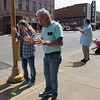 CATHY SPAULDING/Muskogee Phoenix<br /> Wanda and Charles Branham, left, join in a Saturday morning prayer gathering in downtown Muskogee. Several dozen people lined up along Okmulgee Avenue in front of the Muskogee Municipal Building and city parking lot to pray for the city. Participants stood on pieces of tape spaced several feet apart. The Praying for Muskogee gathering was organized by Jordan Howard, pastor of Jubilee Christian Center.