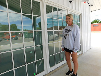 KENTON BROOKS/Muskogee Phoenix Kyla Browning, owner of Raising Arrows Learning Academy, stands by the windows of the new child care center building at 208 W. Knisley St.