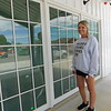 KENTON BROOKS/Muskogee Phoenix<br /> Kyla Browning, owner of Raising Arrows Learning Academy, stands by the windows of the new child care center building at 208 W. Knisley St.