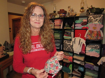 CATHY SPAULDING/Muskogee Phoenix Darla Boydstun has made hundreds of masks, baby clothes and other items in her sewing room. Many items are her own creations.