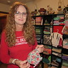 CATHY SPAULDING/Muskogee Phoenix<br /> Darla Boydstun has made hundreds of masks, baby clothes and other items in her sewing room. Many items are her own creations.