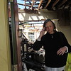 CATHY SPAULDING/Muskogee Phoenix<br /> Pam Smalley exits her house, which was destroyed by two fires, Friday night and early Saturday morning.