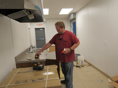 CATHY SPAULDING/Muskogee Phoenix Jesse Ashwood of Able Plumbing cleans up after working on the new kitchen in Muskogee Church of Christ's fellowship hall addition. The addition is about 90 percent finished.