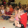"Staff photo by Cathy Spaulding<br /> Early Childhood Center pupils shield themselves from confetti thrown Tuesday morning at a ""watch party"" where the school was named a National School of Character."