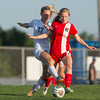 Special photo by Von Castor<br /> Fort Gibson's Katie McCroskey is fouled by a Harrah defender as she dribbles the ball early in the first half Tuesday evening in the Class 4A girls state semifinal in Harrah. Fort Gibson lost, 2-0.