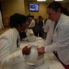 KENTON BROOKS/Muskogee Phoenix<br /> Registered Nurse Kristen Moore holds out her hands for Chaplain Nancy McCoy for the Blessing of the Hands<br /> ceremony at the annual Nurses Week Program at the Jack C. Montgomery VA Medical Center.