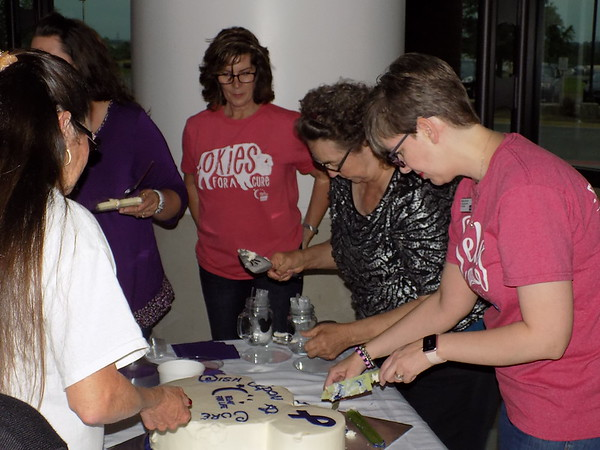 MIKE ELSWICK/Muskogee Phoenix<br /> Melissa McLain, right, and other American Cancer Society volunteers are seen serving cake to cancer survivors and caregivers Tuesday night in advance of Saturday's annual Muskogee County Relay For Life.