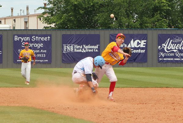 PATRICK KAYS/Phoenix Special Photo Oktaha's Brock Rodden, left, attempts to avoid a force out at second in Friday's Class 2A semifinal game against Dale.