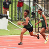 PATRICK KAYS/Phoenix Special Photo<br /> Muskogee's Lonnesha Hill takes off after a handoff from Laila Johnson in the Class 6A 800-meter relay on Friday at Moore High School.