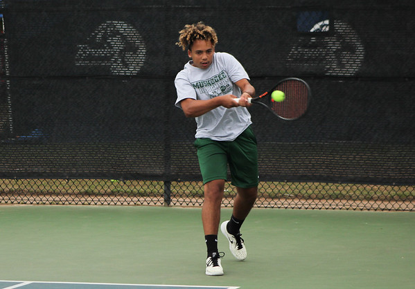 PATRICK KAYS/Phoenix Special Photo Keke Arnett returns a shot for Muskogee in No. 1 doubles action at the OSSAA state tennis championships on Friday in Oklahoma City.
