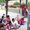 Staff photo by Harrison Grimwood<br /> Doug Walton of the Muskogee County Health Department talks to third-graders from Benjamin Franklin Science Academy on Wednesday at the Muskogee Farmers Market. Walton talked about basic horticulture and gave a bean to each student for them to try growing.