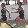 MIKE KAYS/Muskogee Phoenix<br /> Muskogee's Alexis Boyd hands off to Nydeary Howard in the Class 6A girls 800-meter relay Friday at Yukon High School. Muskogee just missed the finals in that event but Boyd and Howard were part of the 400 relay that did make the finals, which will run Saturday.