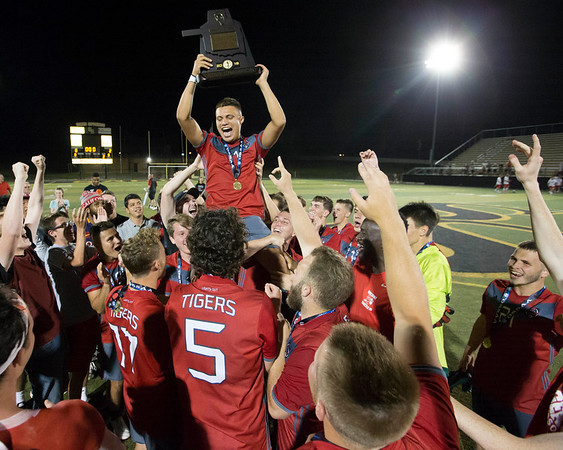 VON CASTOR/Special to the Phoenix<br /> Fort Gibson boys soccer team hoists up Jose Estrada after claiming the Class 4A state championship with a 2-0 victory over Skiatook on Friday.