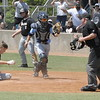 MIKE KAYS/Muskogee Phoenix<br /> Oktaha catcher Brayden Rodden reacts after the tag on a sliding Easton Davis, left, of Beggs during play in the second inning of Friday's Class 3A quarterfinal. Davis was out on the play.